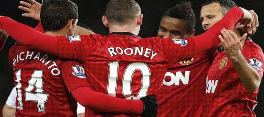 Van Gaal shrugs off title prospects as United go top