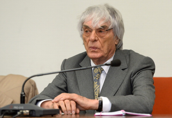 Formula One chief executive Bernie Ecclestone waits at the courthouse in Munich on July 16, 2014, for another day of his corruption trial . The Briton is accused of paying German banker Gerhard Gribkowsky $44 million (32 million euros) in 2006 and 2007 to ensure his continued grip on the motor sports empire he had built up over four decades. AFP PHOTO/ POOL/CHRISTOF STACHE (Photo credit should read CHRISTOF STACHE/AFP/Getty Images)
