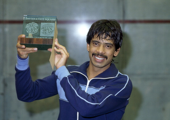 Jahangir Khan of Pakistan with the trophy after becoming the men's British Open Squash Champion at Wembley Arena on 10th April 1984. (Photo by Bob Thomas/Getty Images)