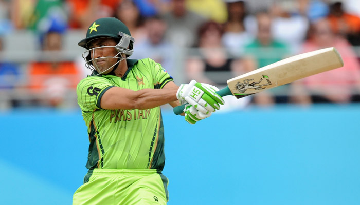 Pakistan's Younus Khan hits the ball while batting against South Africa during their Cricket World Cup Pool B match in Auckland, New Zealand, Saturday, March 7, 2015. (AP Photo/Ross Setford)