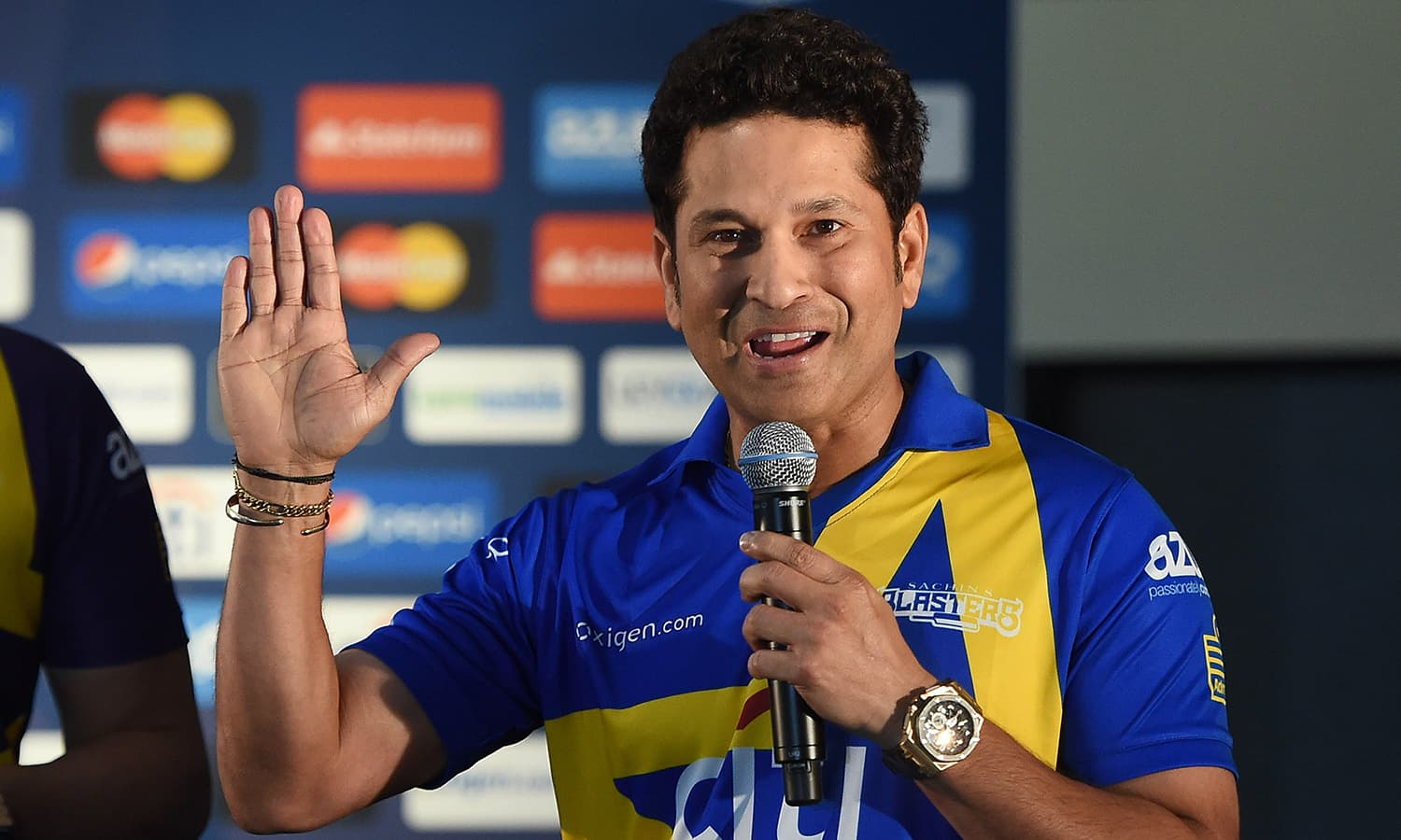 """Retired Indian cricketer Sachin Tendulkar speaks during a press conference in New York on November 5, 2015. Tendulkar and Australia's Shane Warne will lead a lineup of renowned cricket players from around the world in the inaugural """"Cricket All-Stars,"""" a three-game series to be played in Major League Baseball stadiums in New York , Houston and Los Angeles, to promote cricket the US. AFP PHOTO/JEWEL SAMAD"""