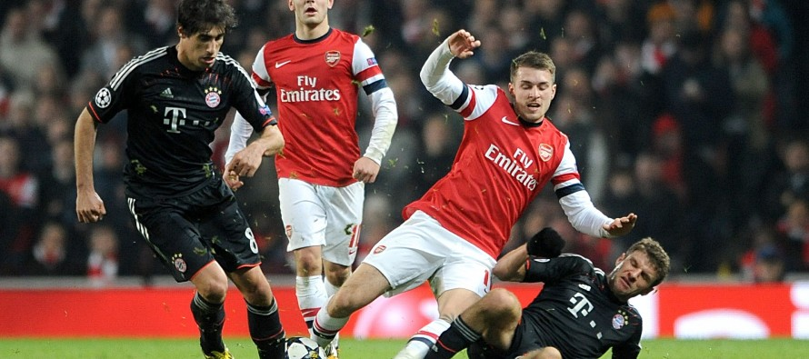 Arsenal's Mertesacker wary of 'wounded' Bayern