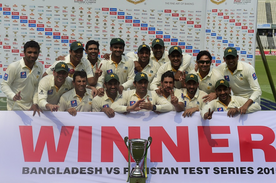 Pakistan cricketers pose for a group photograph with the tournament trophy following the presentation ceremony after the fourth day of the second cricket Test match between Bangladesh and Pakistan at the Sher-e-Bangla National Cricket Stadium in Dhaka on May 9, 2015. AFP PHOTO/ Munir uz ZAMAN (Photo credit should read MUNIR UZ ZAMAN/AFP/Getty Images)