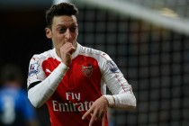 Inspired Ozil fires Arsenal to top spot