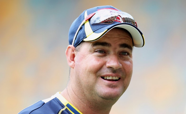 Australia's coach Mickey Arthur stands in the nets ahead their first test cricket match against New Zealand at the Gabba in Brisbane in this November 30, 2011 file photo. Australia media reported on June 24, 2013 that Arthur has been sacked as coach of the national cricket side just two weeks ahead of the start of the Ashes series against England. REUTERS/Jason O'Brien/Files (AUSTRALIA - Tags: SPORT CRICKET HEADSHOT)