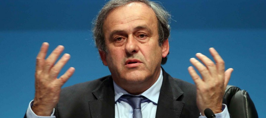 Platini pulls out of FIFA race, vows to clear name