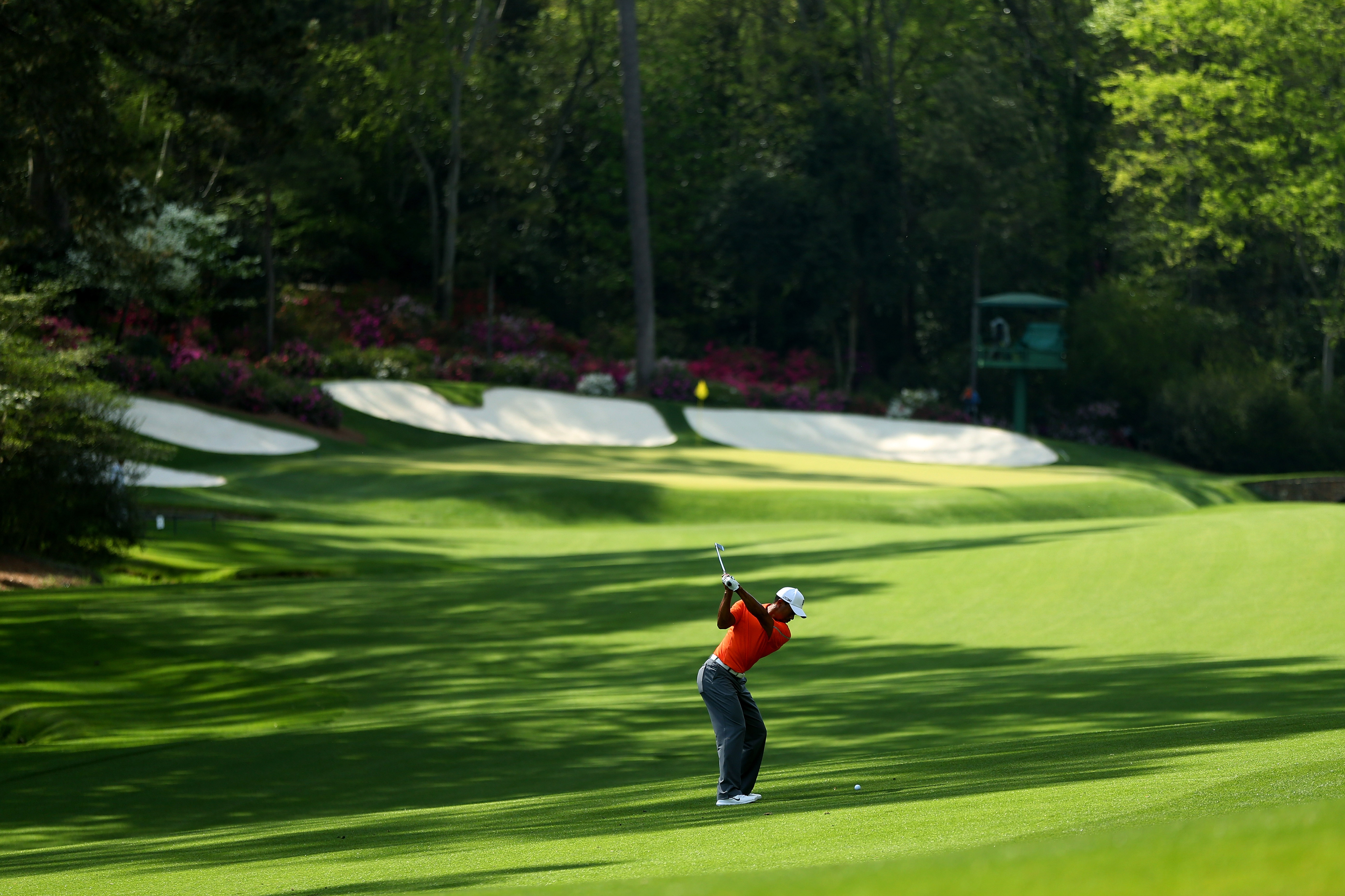 AUGUSTA, GA - APRIL 08:  Tiger Woods of the United States hits a shot during a practice round prior to the start of the 2013 Masters Tournament at Augusta National Golf Club on April 8, 2013 in Augusta, Georgia.  (Photo by Mike Ehrmann/Getty Images)