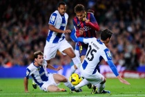 Messi double eases Barca past nine-man Espanyol