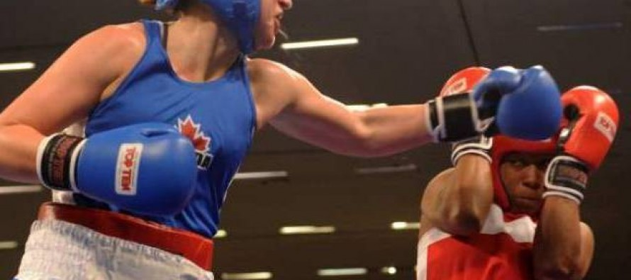 Pakistani female boxers hold the Green Flag high