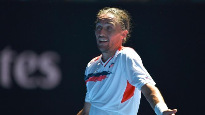 Ukraine's Alexandr Dolgopolov gestures during his men's singles match against Switzerland's Roger Federer on day three of the 2016 Australian Open tennis tournament in Melbourne on January 20, 2016. AFP PHOTO / PETER PARKS-- IMAGE RESTRICTED TO EDITORIAL USE - STRICTLY NO COMMERCIAL USE