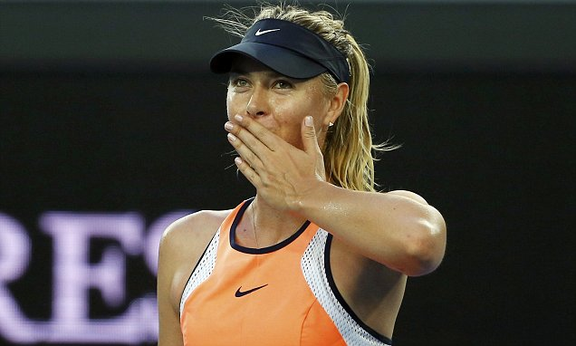 Russia's Maria Sharapova celebrates after winning her first round match against Japan's Nao Hibino at the Australian Open tennis tournament at Melbourne Park, Australia, January 18, 2016. REUTERS/Thomas Peter