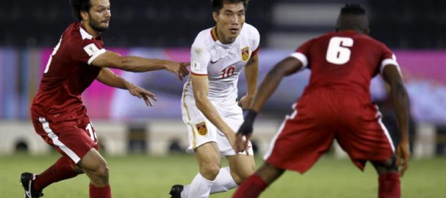 China stun Qatar to move to revive World Cup hopes