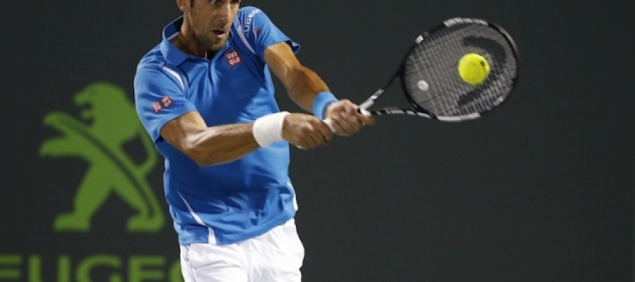 Djokovic withstands back spasms to reach semis