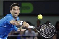 Djokovic hails young guns but warns of long road