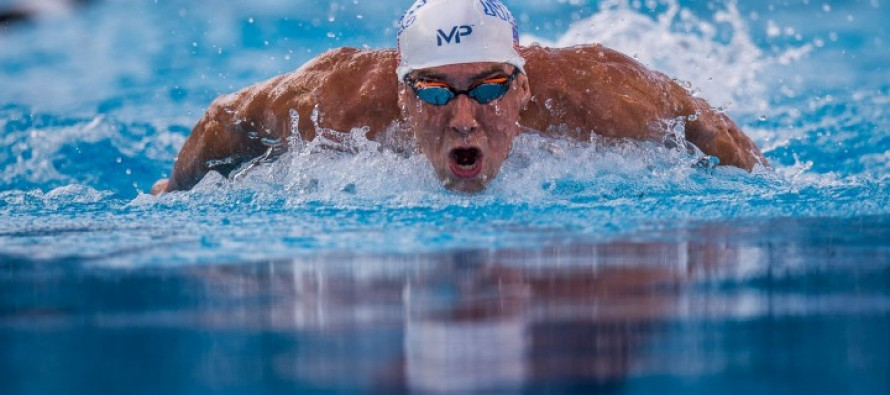 Phelps kicks off Orlando meet with 100m fly win