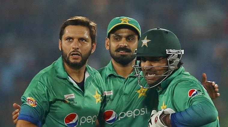 Pakistan's captain Shahid Afridi, left, celebrates with is teammates the dismissal of Bangladesh's Sabbir Rahman during their Asia Cup Twenty20 international cricket match in Dhaka, Bangladesh, Wednesday, March 2, 2016. (AP Photo/A.M. Ahad)