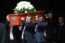 Tributes flow at emotional Crowe funeral