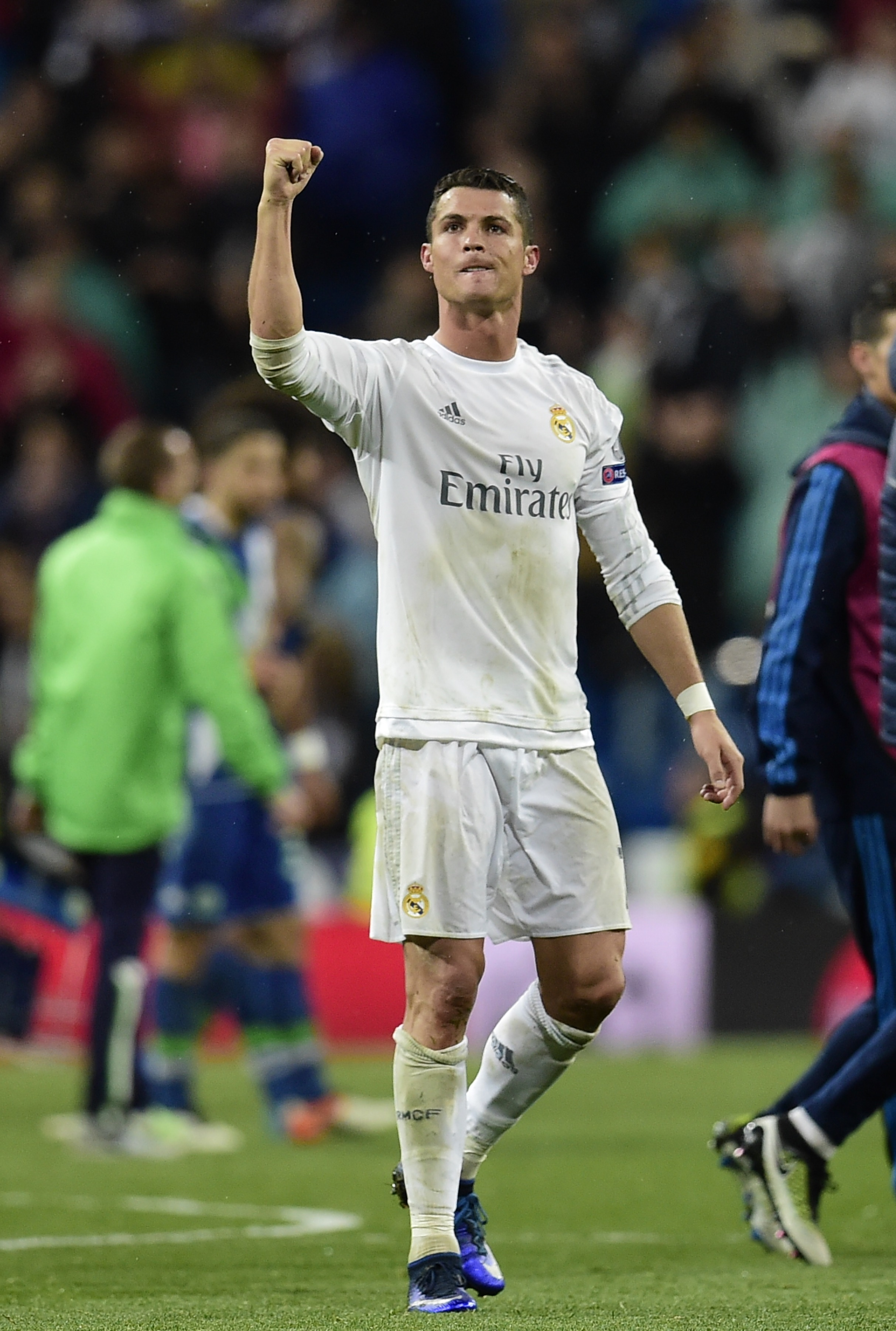 Real Madrid's Portuguese forward Cristiano Ronaldo celebrates at the end of  during the Champions League quarter-final second leg football match Real Madrid vs Wolfsburg at the Santiago Bernabeu stadium in Madrid on April 12, 2016. / AFP PHOTO / JAVIER SORIANO