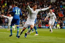 Ronaldo hat-trick fires Real Madrid into semis