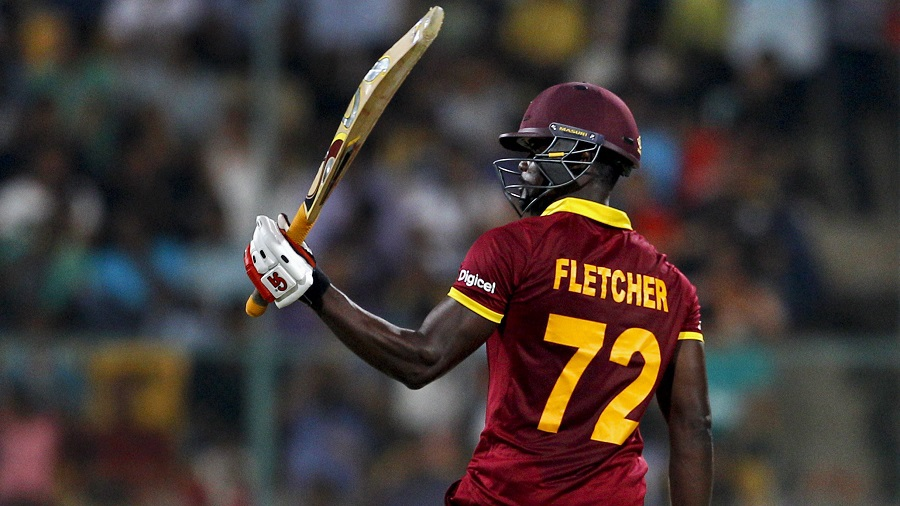 West Indies' Andre Fletcher raises his bat to celebrate scoring fifty runs during their ICC World Twenty20 2016 cricket match against Sri Lanka in Bangalore, India, Sunday, March 20, 2016. (AP Photo/Aijaz Rahi)
