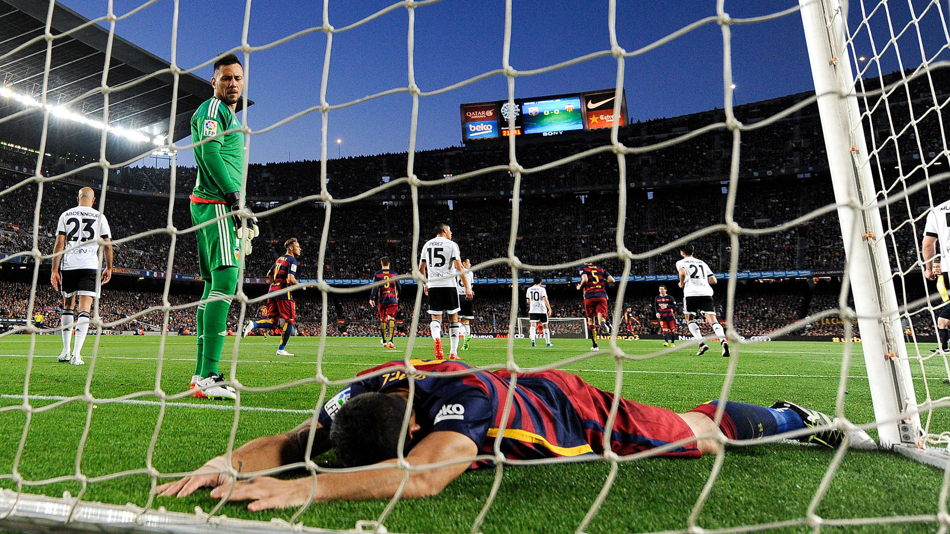 Barcelona's Uruguayan forward Luis Suarez lies in the goal during the Spanish league football match FC Barcelona vs Valencia CF at the Camp Nou stadium in Barcelona on April 17, 2016. / AFP / JOSEP LAGO        (Photo credit should read JOSEP LAGO/AFP/Getty Images)