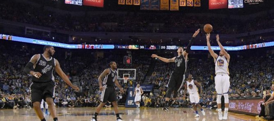 Warriors down Spurs to keep record chase alive