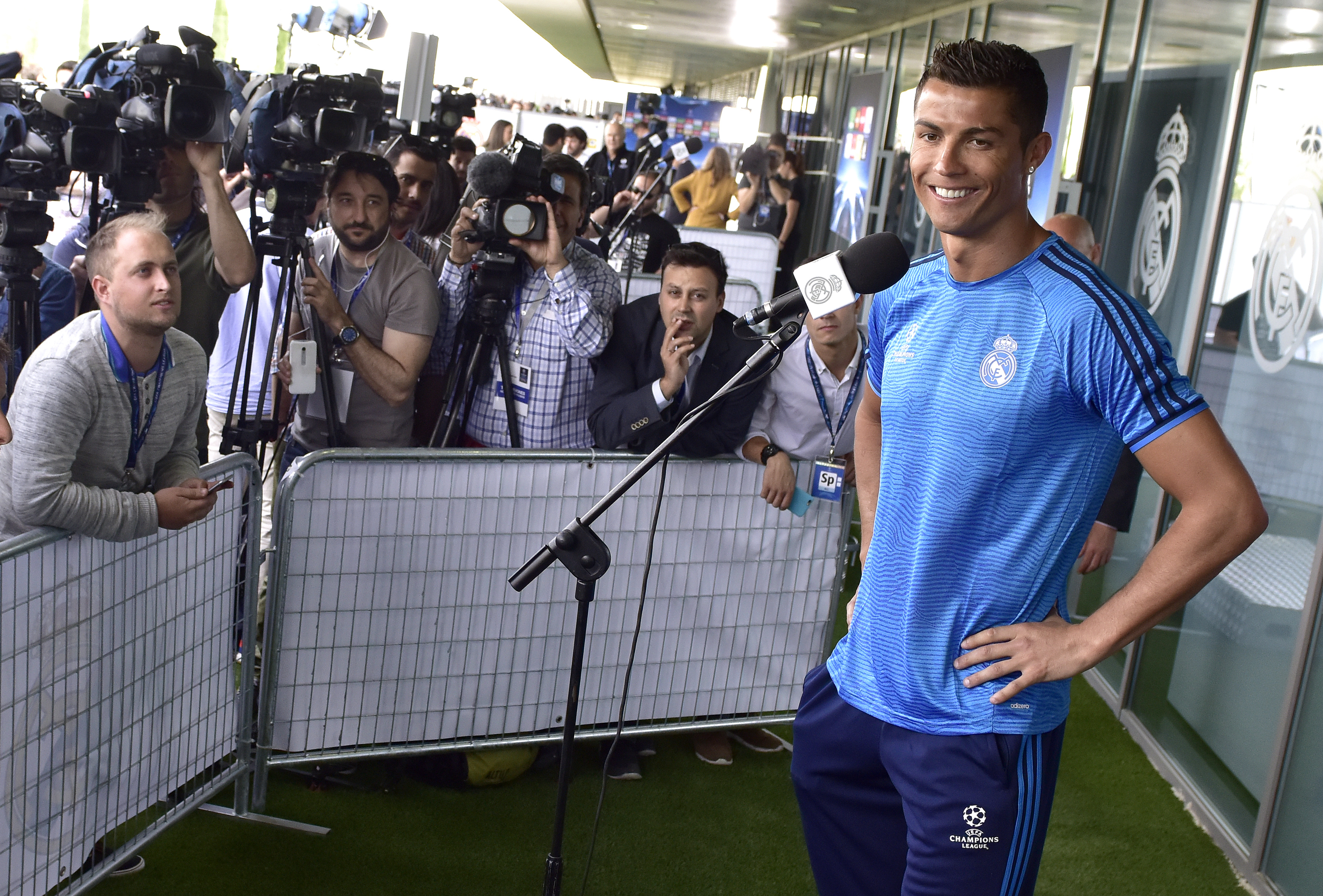 Real Madrid's Portuguese forward Cristiano Ronaldo smiles as he addresses journalists during the club's Open Media Day at Real Madrid sport city in Madrid on May 24, 2016. / AFP PHOTO / GERARD JULIEN