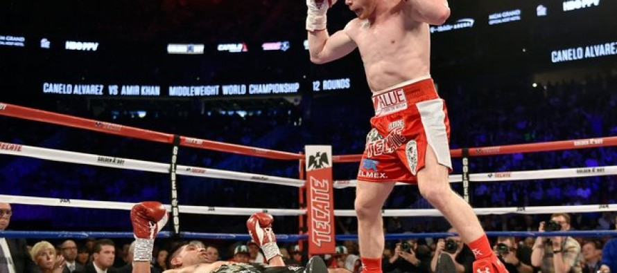 Alvarez KOs Khan to retain WBC middleweight title