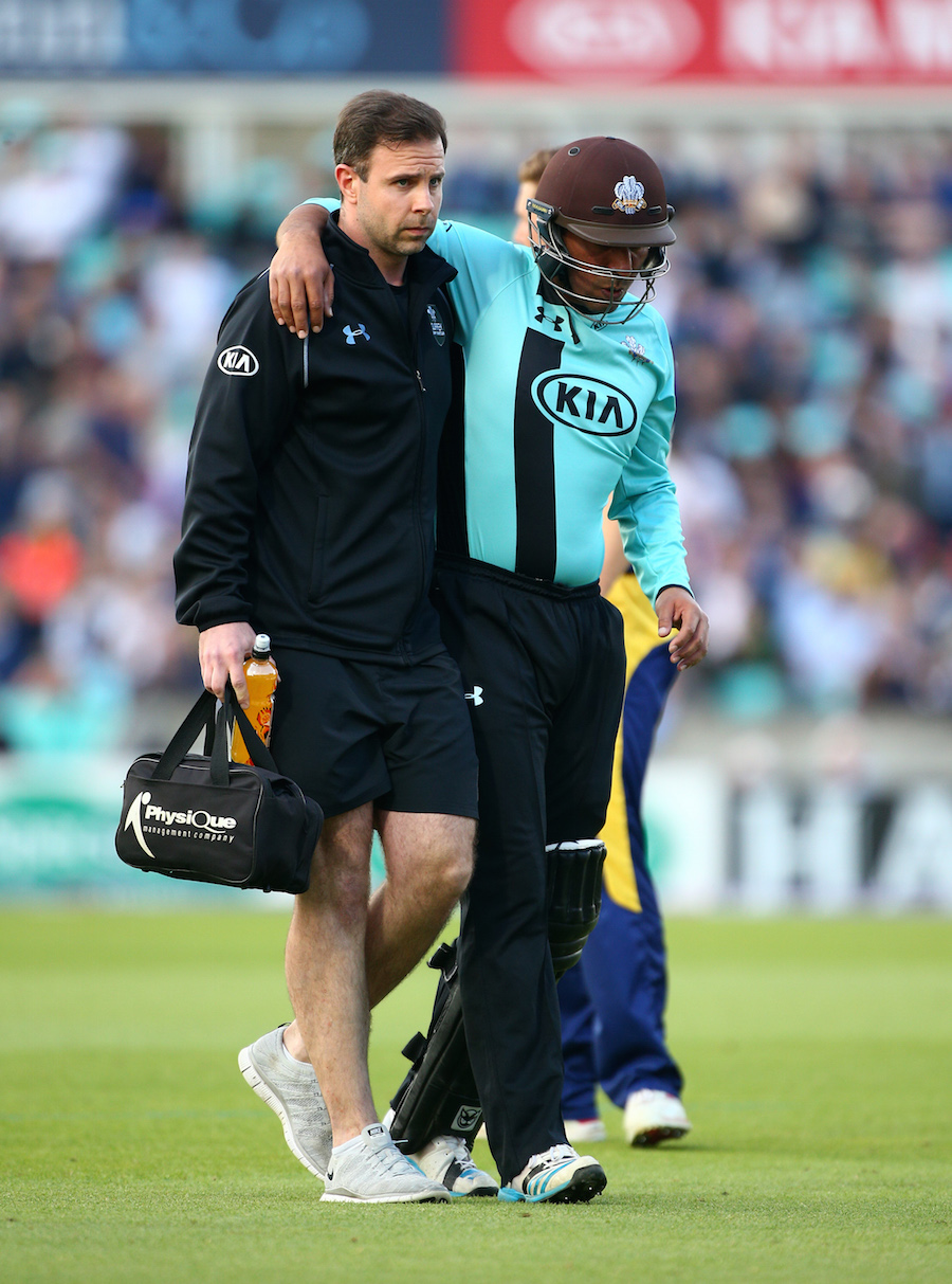 LONDON, ENGLAND - MAY 26: Azhar Mahmood of Surrey is helped off the pitch after picking up an injury during the Natwest T20 Blast match between Surrey and Glamorgan at The Kia Oval on May 26, 2016 in London, England. (Photo by Charlie Crowhurst/Getty Images)