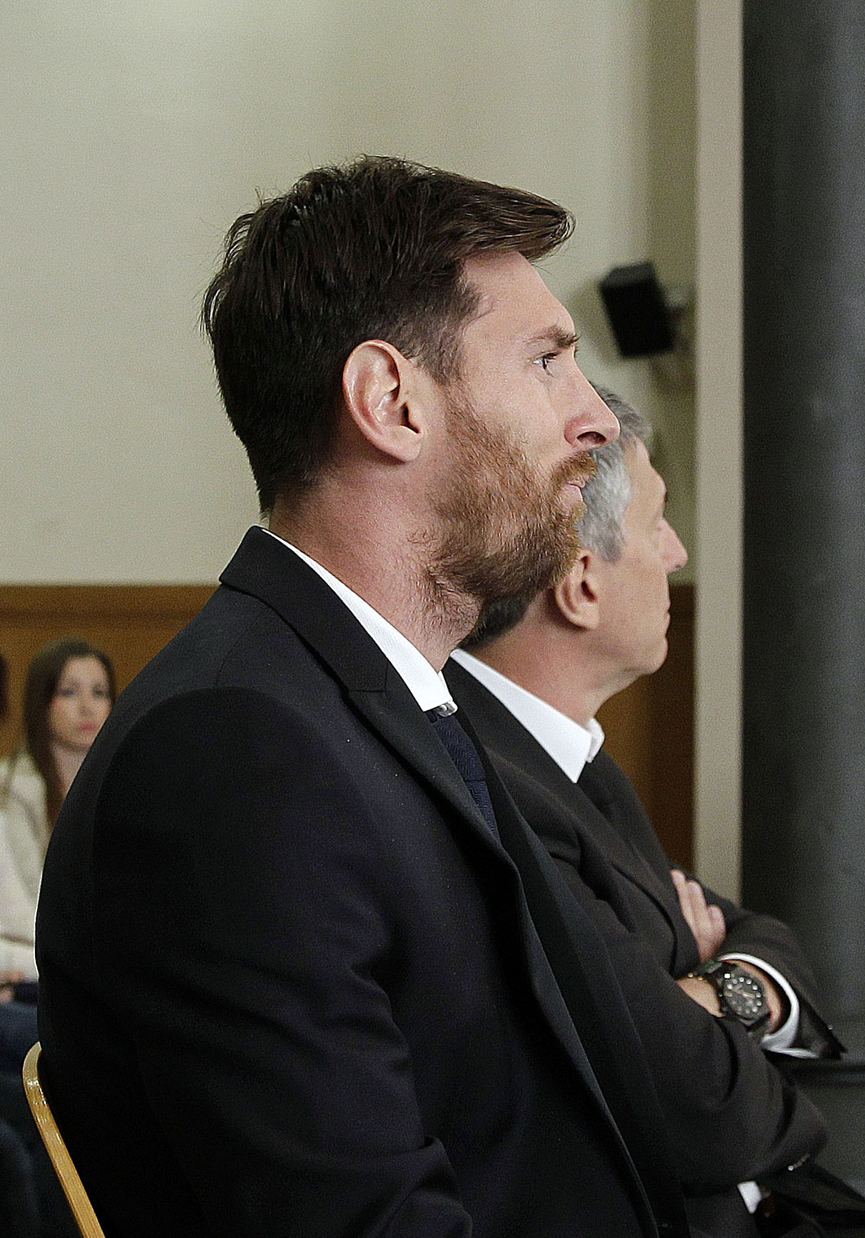 Barcelona's football star Lionel Messi (R) and his father Jorge Horacio Messi listen as they face judges in a tax fraud case at the courthouse of Barcelona on June 2, 2016. The 28-year-old football star was cheered and jeered as he emerged from a van accompanied by his father Jorge Horacio Messi. The two are accused of using a chain of fake companies in Belize and Uruguay to avoid paying taxes on 4.16 million euros ($4.6 million) of Messi's income earned through the sale of his image rights from 2007-09. AFP PHOTO/ POOL/ ALBERTO ESTEVEZ / AFP PHOTO / POOL / Alberto Estevez