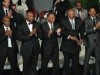 Pallbearers including Heavyweight boxing champions Mike Tyson (L), Lennox Lewis (2-L) and actor Will Smith (R) applaud during the memorial service for boxing legend Muhammad Ali at the KFC Yum Center on June 10, 2016 in Louisville, Kentucky. / AFP PHOTO / Michael B. Thomas