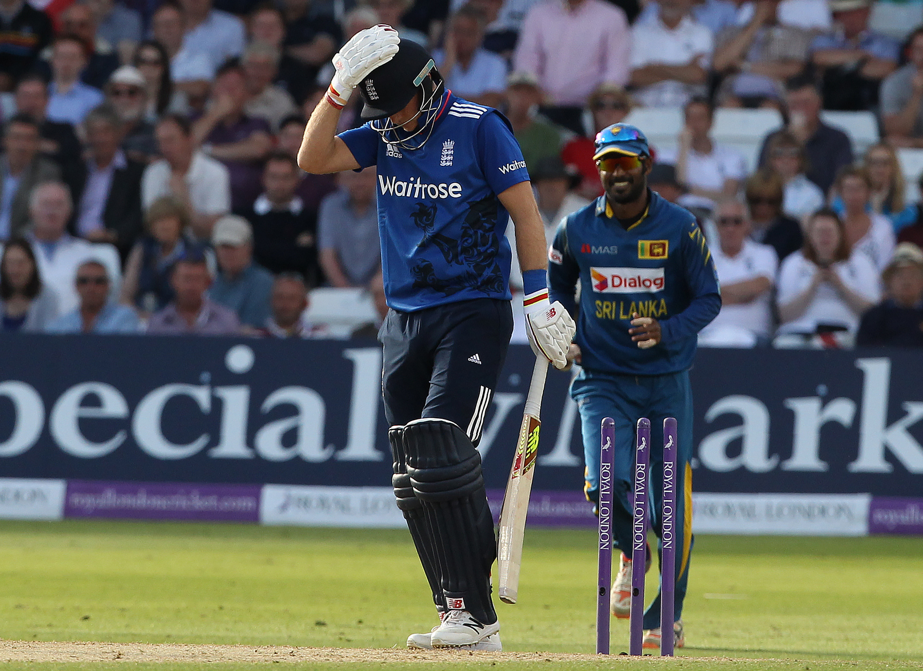 England's Joe Root reacts after being bowled by Sri Lanka's captain Angelo Mathews during play in the first one day international (ODI) cricket match between England and Sri Lanka at Trent Bridge cricket ground in Nottingham, central England, on June 21, 2016. Sri Lanka captain Angelo Mathews top-scored with 73 as his side were held to 286 for nine by England in the first one-day international in Nottingham on Tuesday. / AFP PHOTO / Lindsey PARNABY
