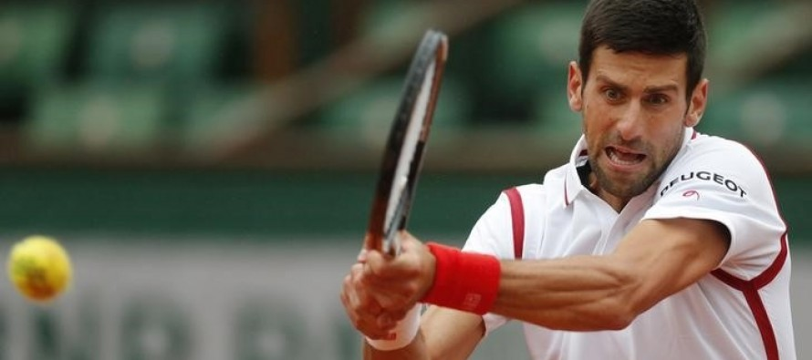 Djokovic labours into French Open quarter-finals