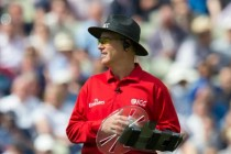 Umpire uses shield to keep trouble at arm's length