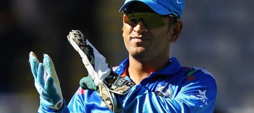 MS Dhoni's wicket-keeping kit and Paes' precious racquets auctioned for charity