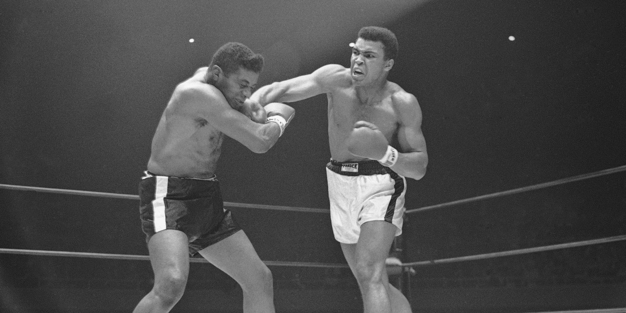 Heavyweight champion Muhammad Ali ( Cassius Clay) moves in with a series of amsshes to the face of challenger Floyd Patterson in the sixth round of their title fight at Las Vegas, Nevada on Nov. 22, 1965. (AP Photo)