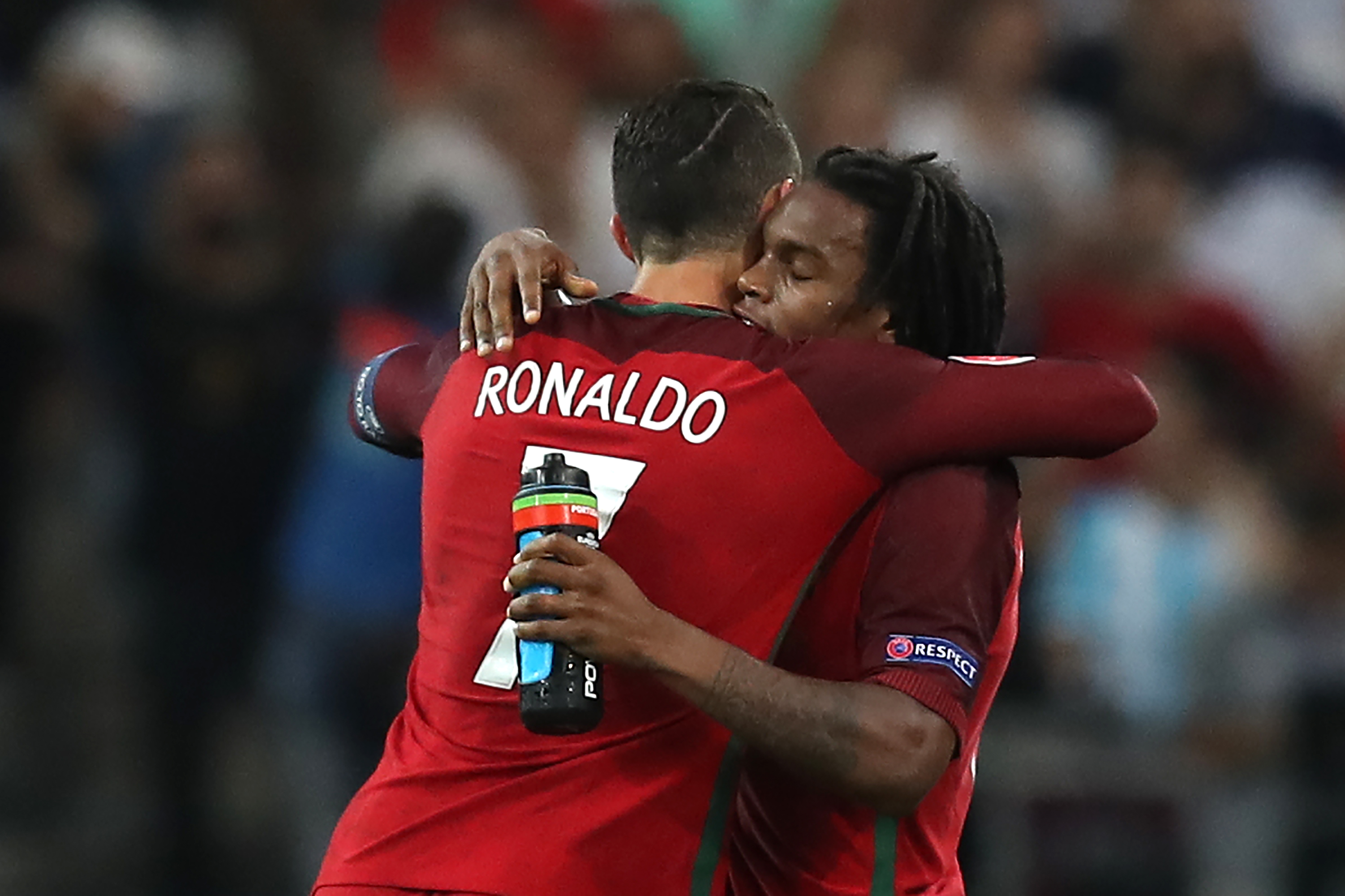 Portugal's midfielder Renato Sanches (R) celebrates with Portugal's forward Cristiano Ronaldo after scoring during the Euro 2016 quarter-final football match between Poland and Portugal at the Stade Velodrome in Marseille on June 30, 2016. / AFP PHOTO / Valery HACHE