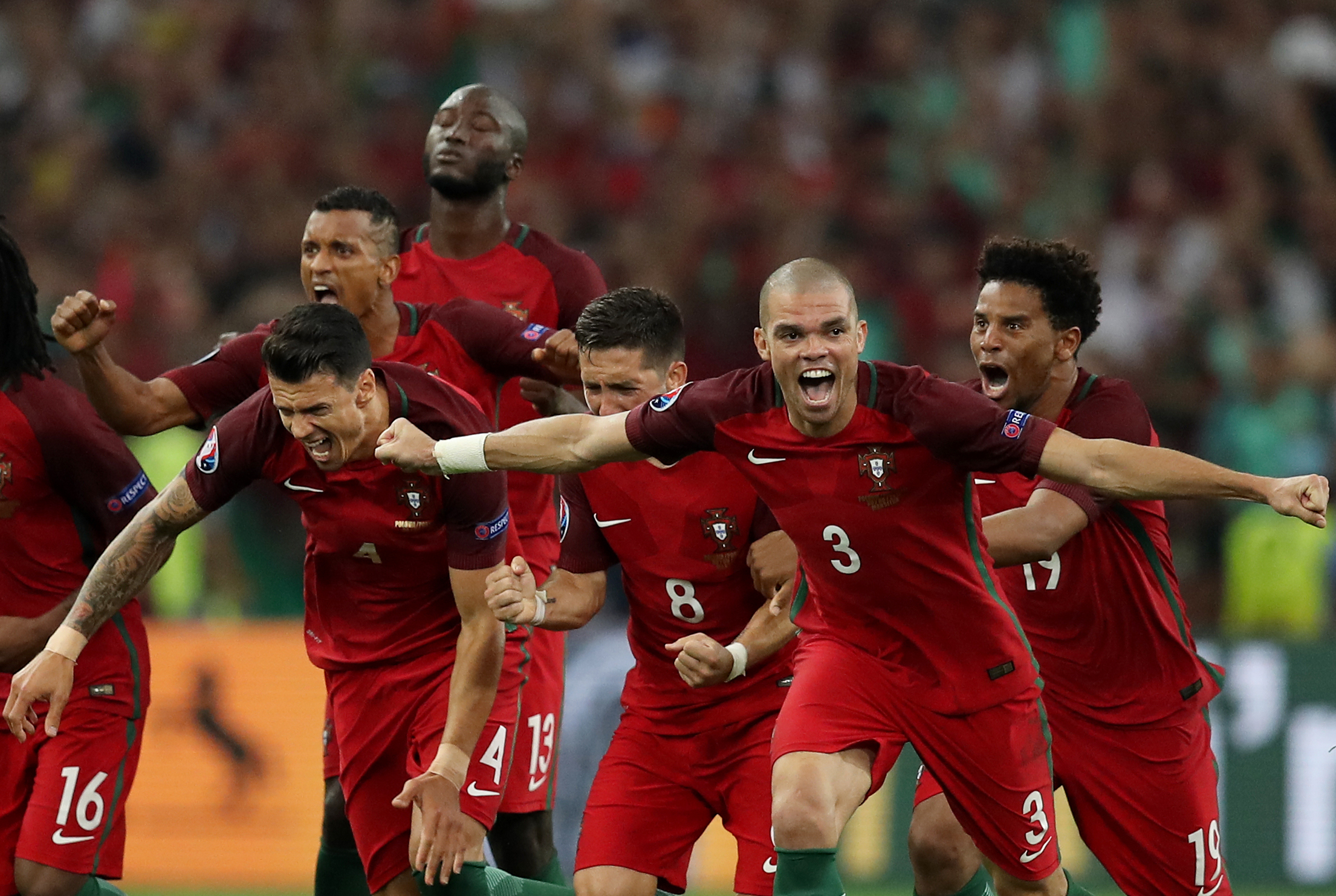 Portugal's players celebrate after winning the Euro 2016 quarter-final football match between Poland and Portugal at the Stade Velodrome in Marseille on June 30, 2016. / AFP PHOTO / Valery HACHE