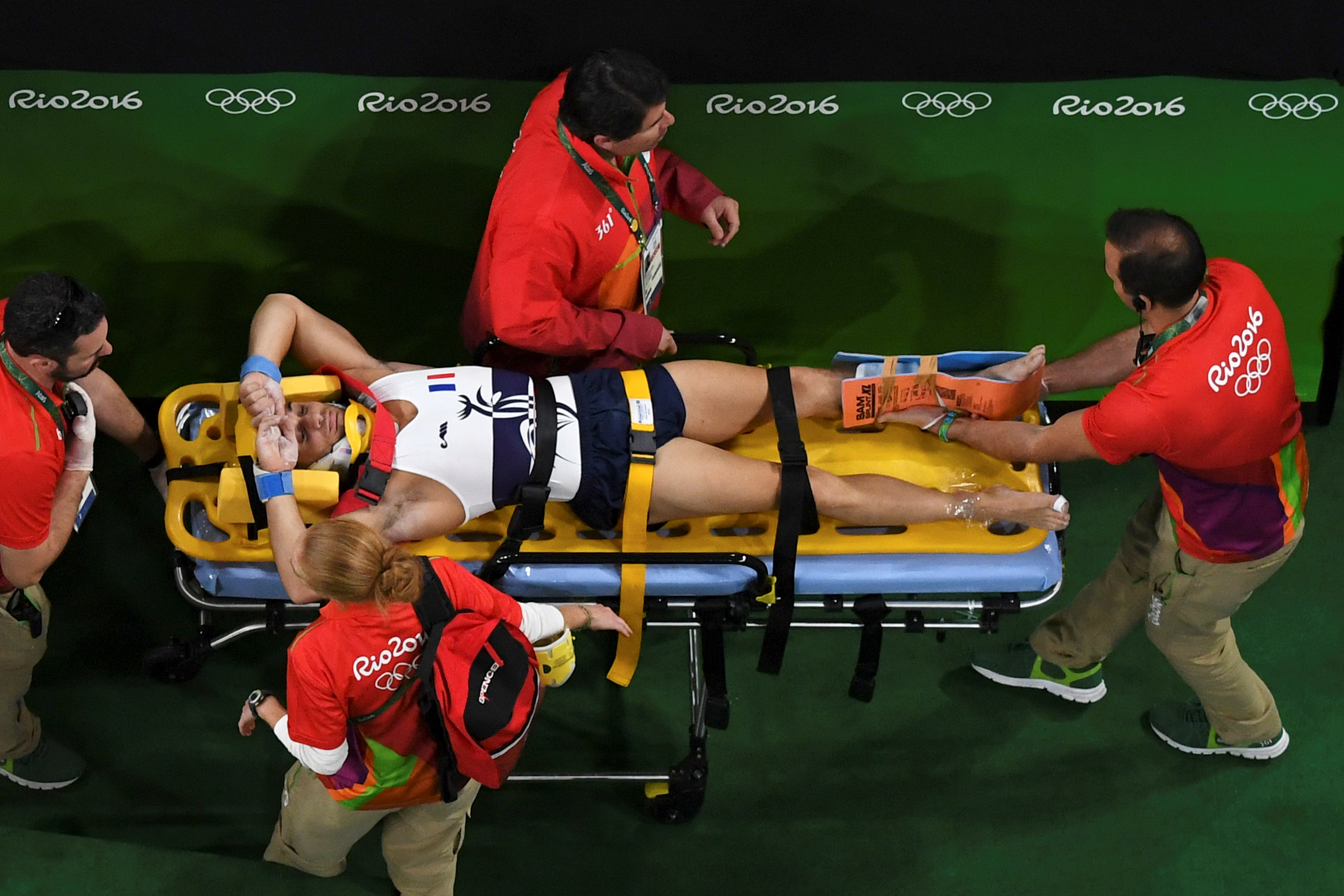 An overview shows France's Samir Ait Said being stretchered off after being injured while competing in the qualifying for the men's vault event of the Artistic Gymnastics at the Olympic Arena during the Rio 2016 Olympic Games in Rio de Janeiro on August 6, 2016. / AFP PHOTO / Antonin THUILLIER