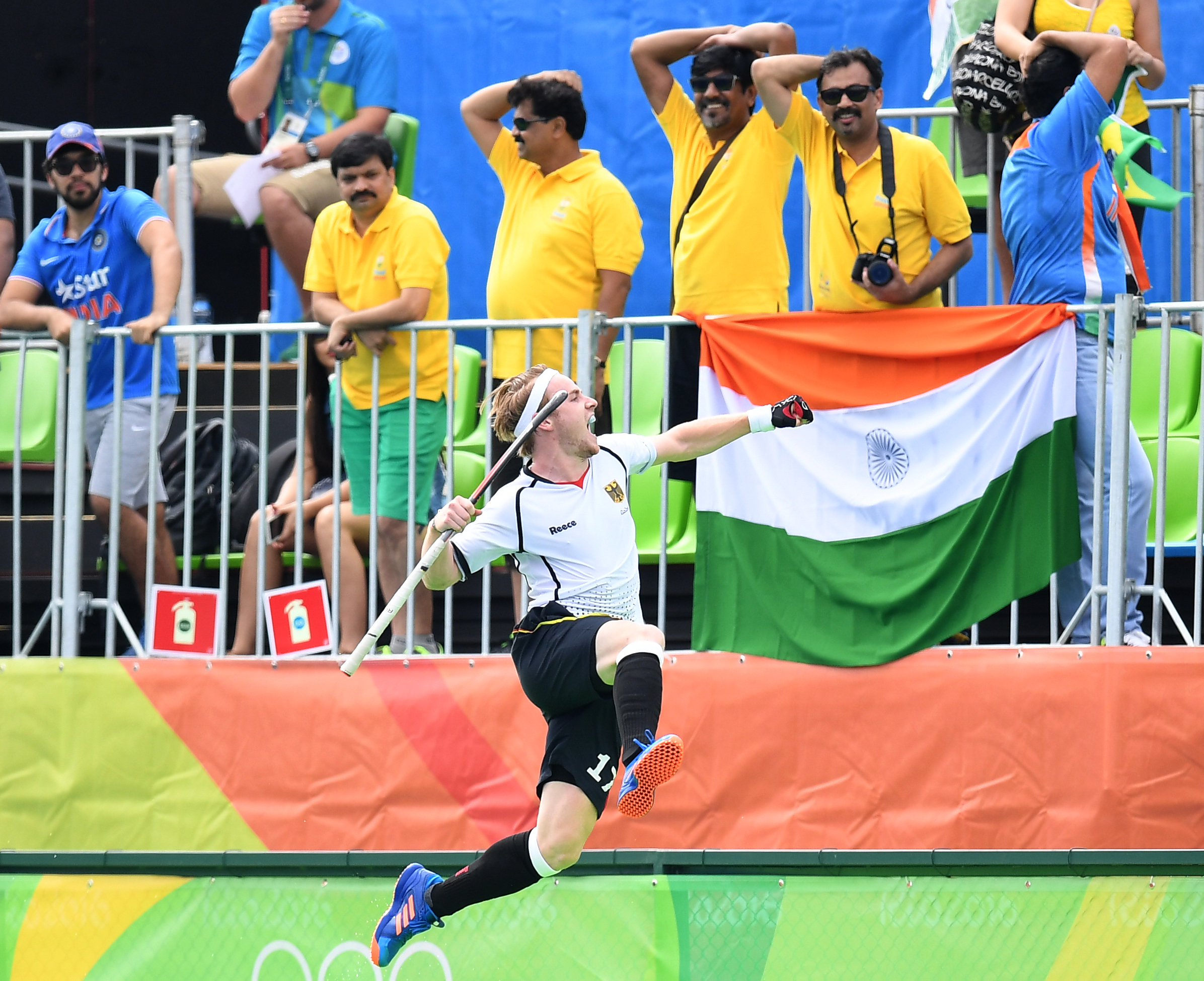 Germany's Christopher Ruhr celebrates scoring a goal during the men's field hockey Germany vs India match of the Rio 2016 Olympics Games at the Olympic Hockey Centre in Rio de Janeiro on August, 8 2016. / AFP PHOTO / MANAN VATSYAYANA