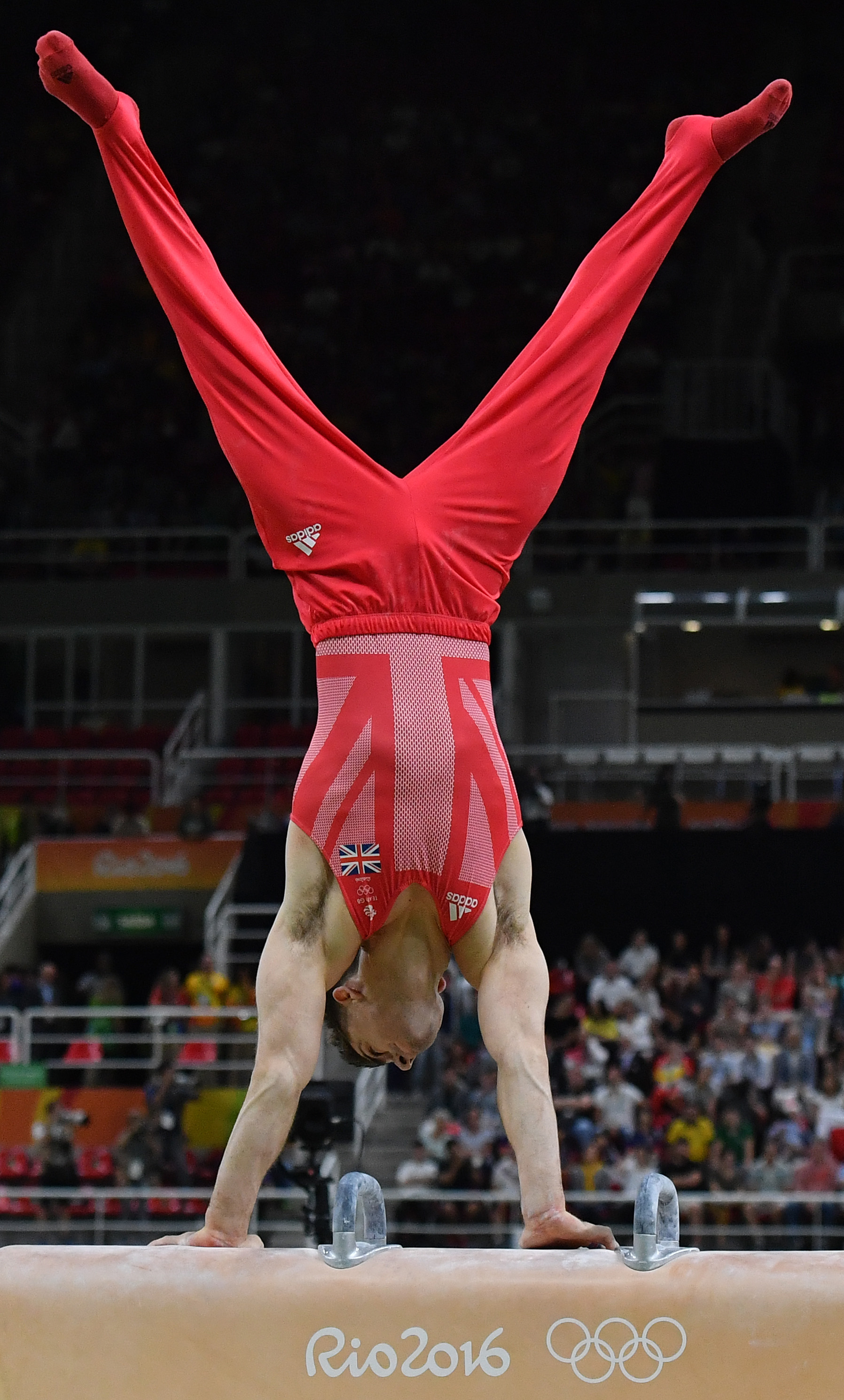 Britain's Max Whitlock competes in the pommel horse of the men's team final of the Artistic Gymnastics at the Olympic Arena during the Rio 2016 Olympic Games in Rio de Janeiro on August 8, 2016. / AFP PHOTO / Ben STANSALL