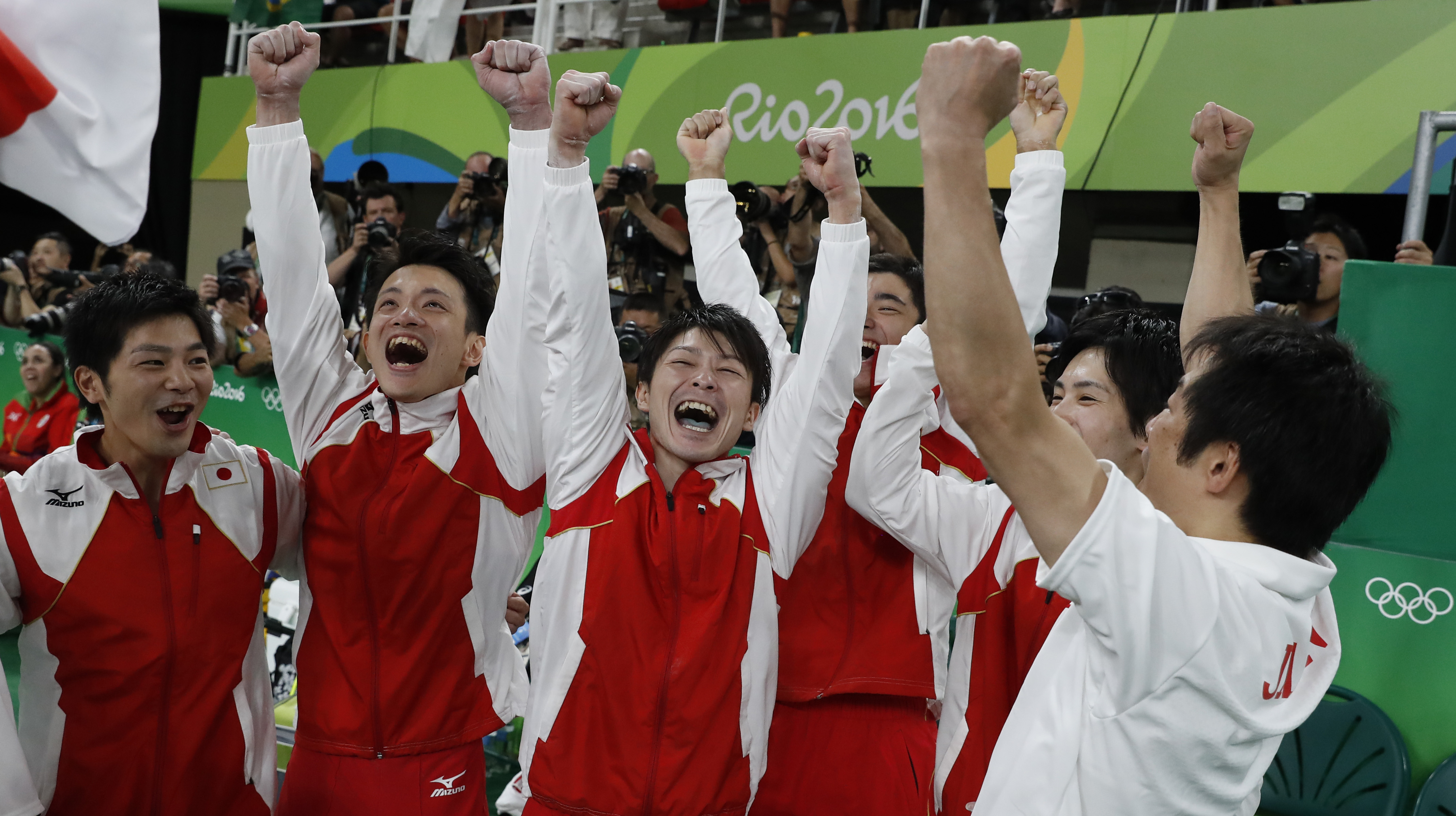 Japanese team celebrate after winning the men's team final of the Artistic Gymnastics at the Olympic Arena during the Rio 2016 Olympic Games in Rio de Janeiro on August 8, 2016. / AFP PHOTO / Thomas COEX