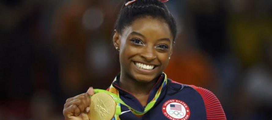 Biles bows out with four gold and name in lights
