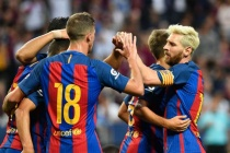 Suarez and Messi lead Barca past Leicester