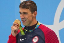 Phelps triumphs again as first major doping cases revealed
