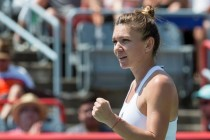 Halep eases past error-prone Keys to Montreal title