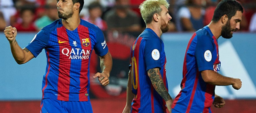 Suarez gives Barcelona edge in Supercup
