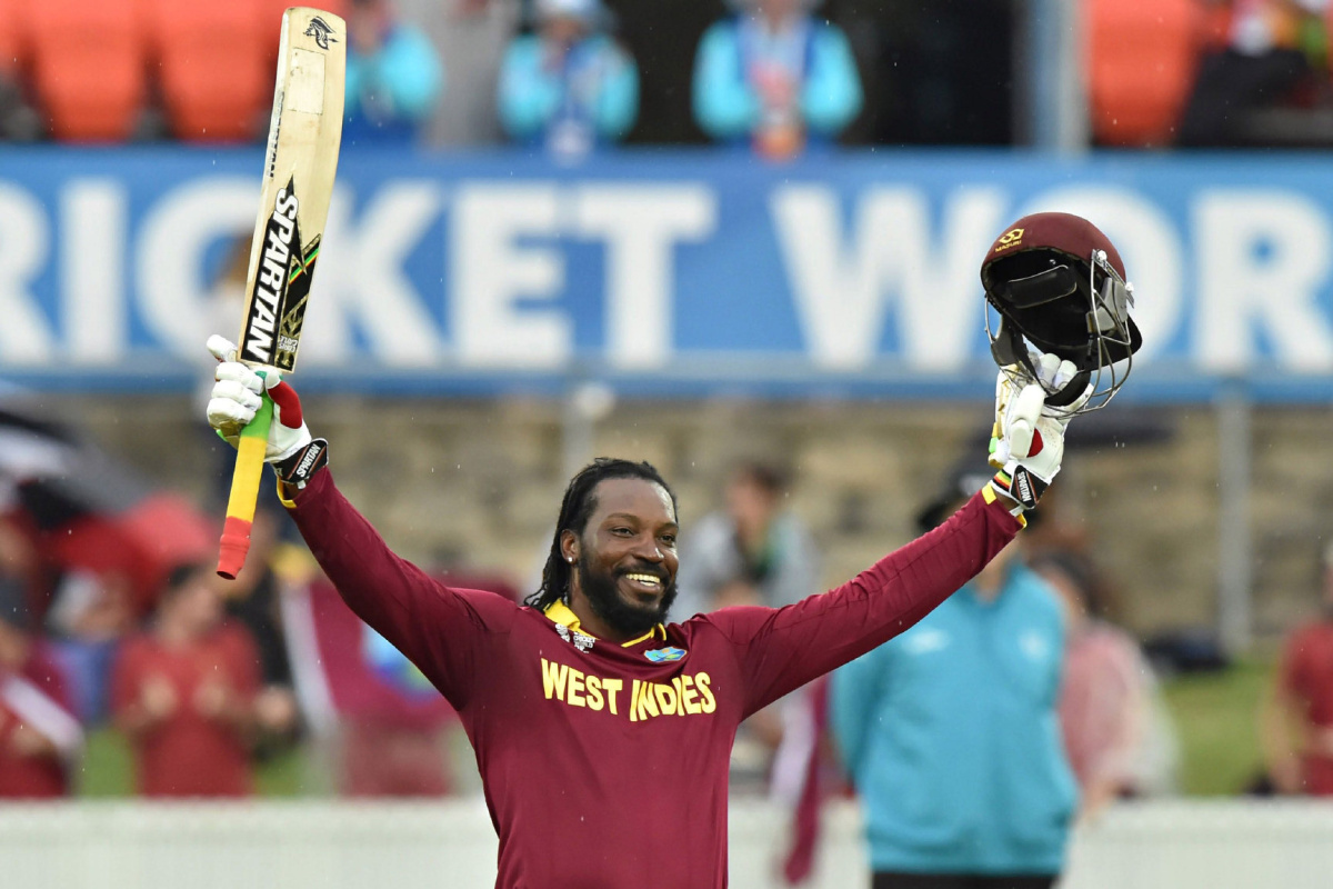 TOPSHOTS ALTERNATIVE CROP --IMAGE RESTRICTED TO EDITORIAL USE - STRICTLY NO COMMERCIAL USE-- TOPSHOTS West Indies Chris Gayle celebrates his double century (200 runs) during the 2015 Cricket World Cup Pool B match between the West Indies and Zimbabwe at The Manuka Oval in Canberra on February 24, 2015. AFP PHOTO/PETER PARKS --IMAGE RESTRICTED TO EDITORIAL USE - STRICTLY NO COMMERCIAL USE--PETER PARKS/AFP/Getty Images