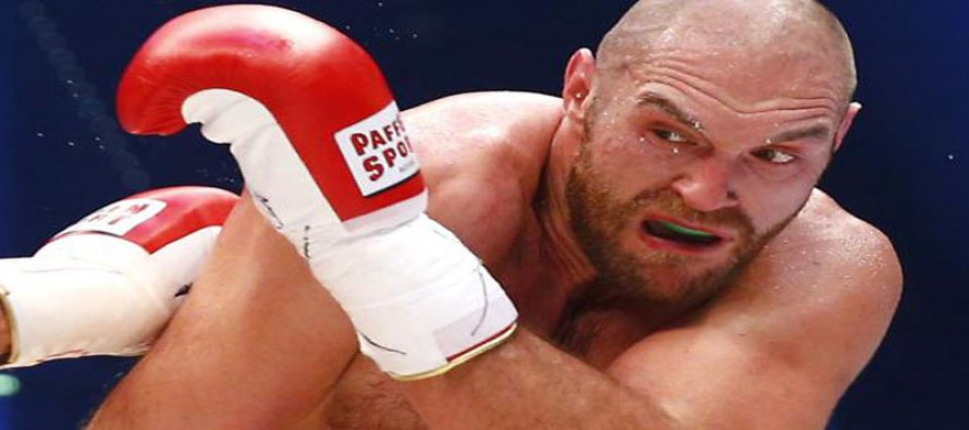 Fury vacates world titles, has boxing licence suspended