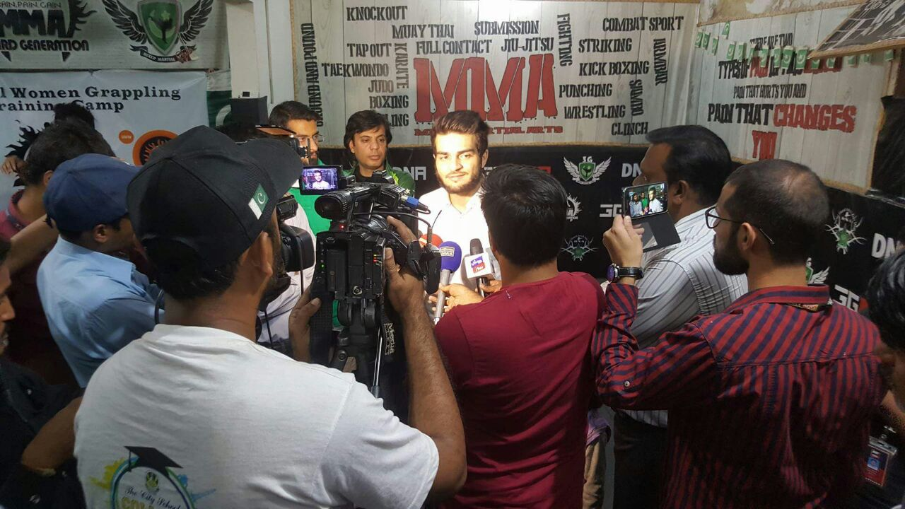 Ahmed 'Wolverine' Mujtaba talks to reporters at 3GMMA headquarters in Karachi.